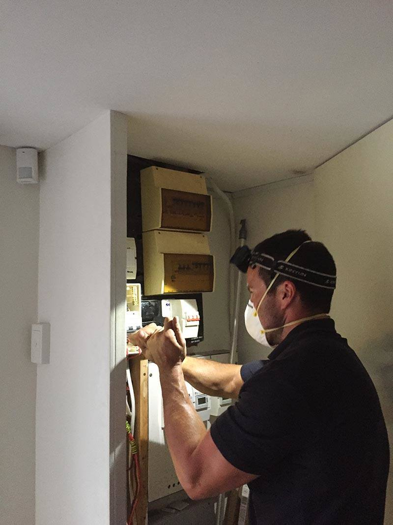 after hours electrician in Perth is fixing wires